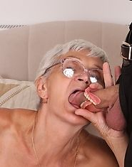 Granny in glasses gives head to two young studs