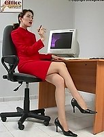 Administrator In Bright Red Suit And Nylons with High Heels
