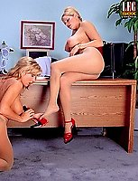 Naked lesbians kissing in the office