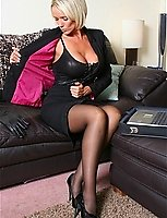 Lucy In A Black Business Suit With Black Lace Top Stockings