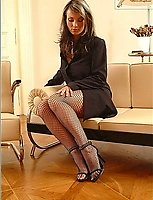 Sexy Brunette Babe In Sandals, Business Suit And Fishnet Black Pantyhose