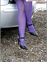 Purple Pantyhose And Skirt Up As Cars Pass By On the Road