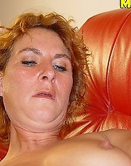 Mature slut playing on her sofa