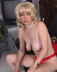 Blonde housewife playing on her couch