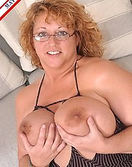 This lovely horny housewife shows her tits for cock