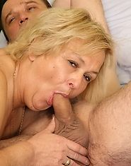 Horny granny seduces her sleeping lover in bed