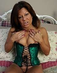 MILF in corset masturbates with glass in her twat