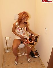 MILF sucking a big cock on the crapper