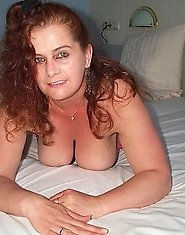Big titted, mature and horny as hell